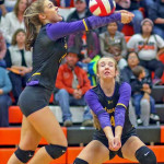 Photo by Andrew Turck            Teammates Sophia Timm (hitting the ball) and Taryn Wommack going for the ball in their game against Hardin last Thursday.