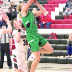 Joliet's Seth Bailey goes up for a layup during the District 4B tournament in Huntley Project. The J–Hawks lost to Red Lodge in the consolation game to take 4th place. Only the top three teams advanced to the Southern B Divisional tournament this week at MetraPark. Photo courtesy Michelle Carpenter