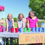 Orian Oglesby, Aria Oglesby, Piper Ewing and Molly Neff are seen at their lemonade stand across from the Laurel Sports Complex last Thursday. With the temperatures hovering around 90 degrees, they were expecting a brisk business from the participants in the track camp taking place across the street.