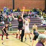 Photo courtesy Stephanie Perdue–Wetmore                        James Wetmore (#35) tips-off the game against Harlowton's defense.