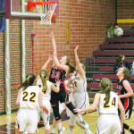 Photo courtesy Stephanie Perdue–Wetmore                        Isabelle Adams (#33) combats a crowd of Harlowton defenders for a lay-up.