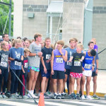 Outlook photo by Connor Waddingham                        The runners in this year's SAM's Run line up before the start of the 5k. Levi Taylor (blue shorts) took first place overall in the race for the third year in a row.