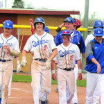 Outlook photo by Connor Waddingham                        Seniors (from left to right) Cash Golden, Deklan Harper, and Connor Polkowske trotting back to the dugout after celebrating one of Harper's eight home runs this season.