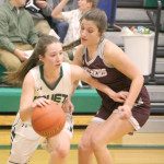 Outlook Photo by Connor Waddingham                        Lady J-Hawk senior Sophia Gillespie drives past a Roundup defender as she looks to score. Joliet lost by six points at home to Roundup.