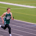 Outlook photos by Connor Waddingham                        Senior Ry Olson of the Joliet J-Hawks running in his last relay of the season. Olson is qualified for state in the high jump, long jump, and triple jump.