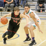 Outlook Photo by Connor Waddingham                        Park City Panthers junior Garrett McMillen dribbles by a Plenty Coups defender and looks to score, against the Plenty Coups Warriors at Alterowitz Gym on the campus of Montana State University-Billings.