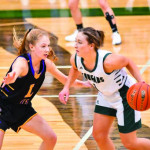 Photo courtesy of Gloria Allwin  Lady Locomotive Grace Timm guards a Columbus player during their game last Friday. Laurel lost the game by 1 point in double over time. Columbus won 41-40.