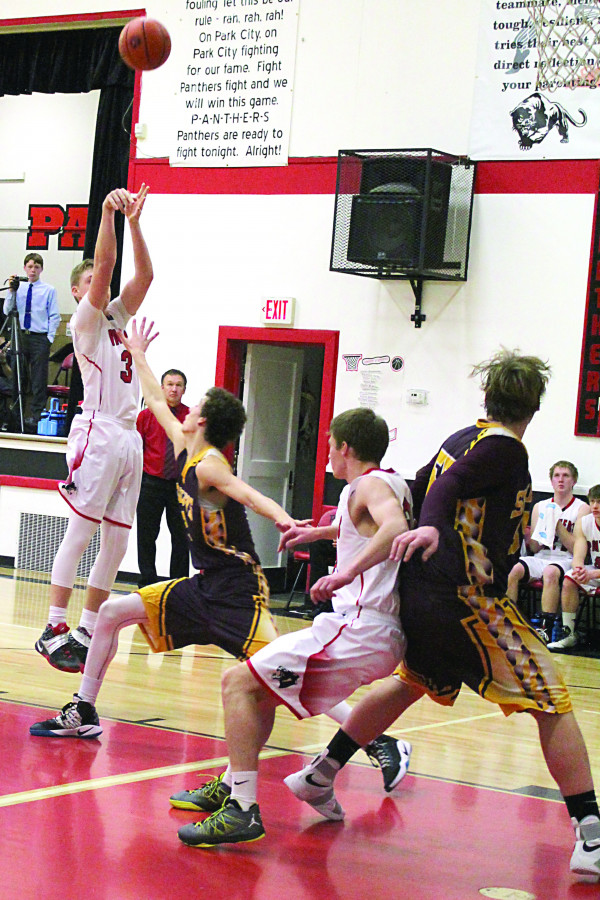 Photos courtesy of Kim Flemmer.  Talon Johnstone shoots for two as Brandon Flemmer makes a block on a Bridger player.