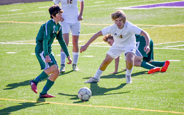 Courtesy photo. Sophomore Bryce Adkins scrambles to defend a Whitefish player during Saturday's playoff game.
