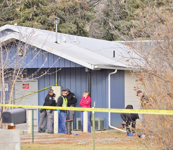 "Outlook photos by Chris McConnell                        Law enforcement authorities investigate the crime scene where a body of a male was discovered by a Park City postal employee on Wednesday morning. The death was ruled as ""suspicious"" and an autopsy was scheduled in Billings yesterday afternoon."