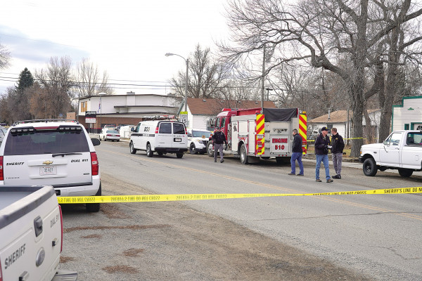 The Stillwater County Sheriff's Department and various law enforcement investigators cordoned off a portion of South Clark St. after the body of a male was discovered behind the Park City Post Office yesterday morning