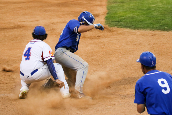 Photos by Hailey Maurer.  Laurel Dodger Kanyin Moran slides into third in a recent game against the Billings Blue Jays. The Dodgers swept the Blue Jays in both games.