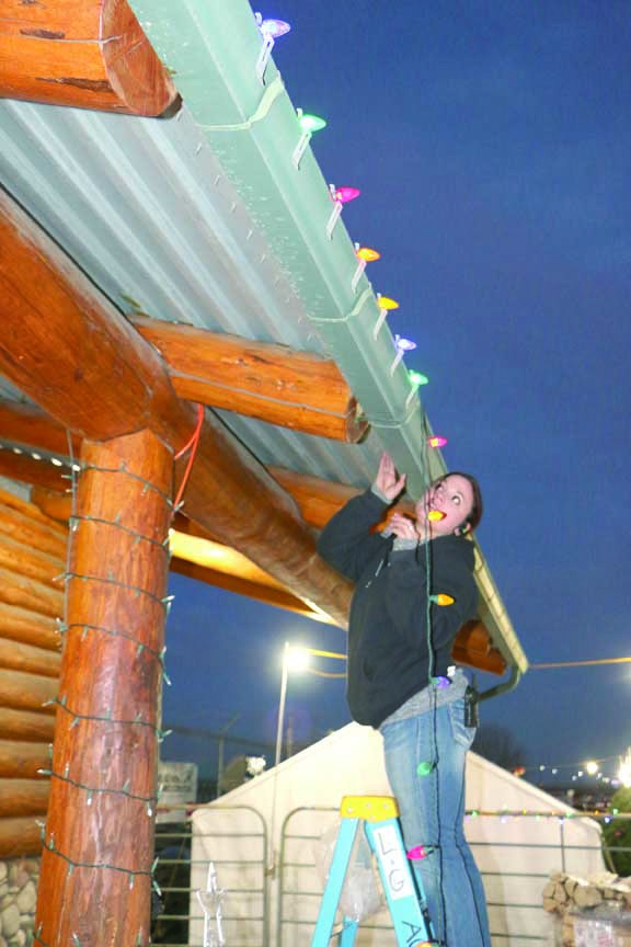 Laurel Ace Hardware assistant store manager Heather Gonzales spent some time Tuesday evening attaching lights to the outside of the store. She said lights are selling well this year and the warmer weather has made it easier for people to put lights up.