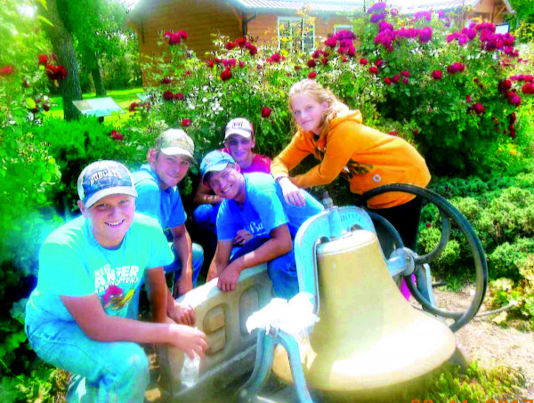 FFA members assisted the Laurel Garden Club move the old North School cornerstone earlier this month. From the left they are Kyle Robertus, Toby Wisecup, Brett Robertus, Ryan Robertus and Alyssa Robertus.