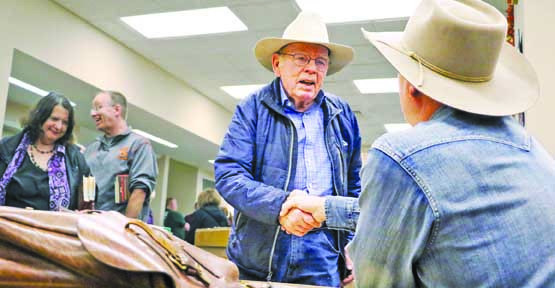 """Craig Johnson visits with fans of his Sheriff Walt Longmire novels at the Big Horn County Library in Hardin. The author became executive producer for the television production of """"Longmire,"""" which can be seen on Netflix."""