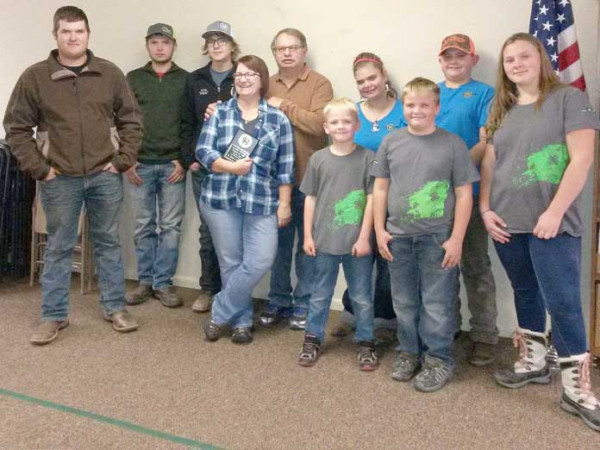 Courtesy photo. The Reed family, which includes Bob, Michelle and Megan, were recently honored by the Rockvale Ramblers 4-H Club for service to the organization and the community. The Reeds were among notable folks who received the Carbon County Friend of 4-H Award this year. Shown from the left are Nic Reed, Colton Whitney, Noah Salo, Michelle Reed, Bob Reed, Jakeob Wilson, TassinTedeschi, Mikeal Wilson, RileyTedeschi and Caitlynn Wilson. Not shown is Megan Reed Sayer.