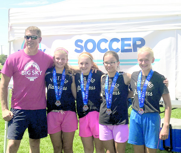 Photo Courtesy of Crystal Nagel.  The Laurel Kickin' on up the field soccer team won a gold medal in the 11 and 12 year old Gold division bracket at the Big Sky State Games July 15-16. From the left are Coach Tom Maack, Chloe Knopp, Mya Maack, Abby Nagel and Gentry Davidson.