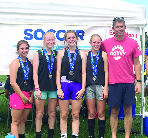 Photo Courtesy of Crystal Nagel.  The Laurel Girls took the gold medal in the 13-14 year old division in the 3-on-3 soccer tournament at the Big Sky State Games July 15-16. From the left is Baylee Nagel, Sierra Branstetter, Morgan Maack, Anna Cole and Coach Tom Maack.