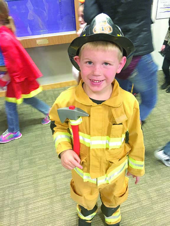 Outlook photo by Crystal Nagel Where's the fire? This little fireman is ready to join the Laurel Volunteer Fire Department. Hayden Cramer is decked out for the Halloween parade at West Elementary School and has all his gear.