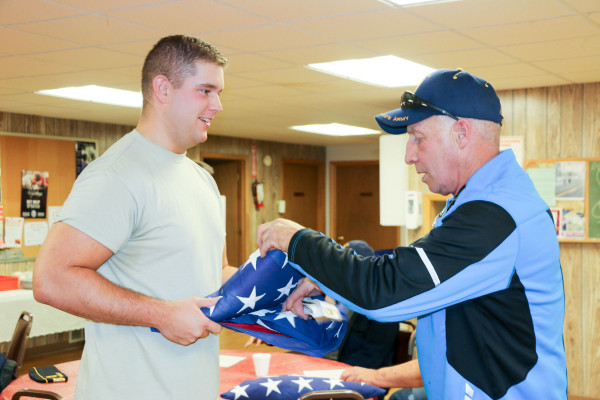 Before the Thursday, Oct. 12, meeting of the Laurel American Legion Post #123, Army Spec. Henry Oyler, the Regional Coordinator for Military Funeral Honors gave lessons in the proper folding of the American flag to members who volunteer at the funerals of veterans. Spec. Olyer, on the left, is shown working with Legionnaire Ray Southworth.