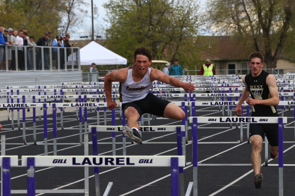 Chris Abell clips the hurdle during the running of the 110-meter high hurdles.