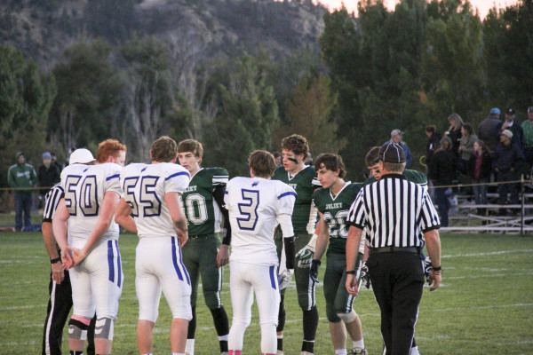 Outlook photo by Chris McConnell. The Joliet and Lone Peak team captain's meet at mid-field before the Homecoming game Friday night. The J-Hawks dominated the game from the opening kickoff and won 56-21.
