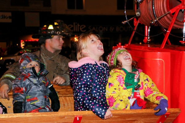 Photo by David Keyes. Kinley Groshelle, left, and Lily Hiltabrand screamed with delight as the fireworks went off. Firefighter Shane Willis and Pierson Markegard were a little more restrained.