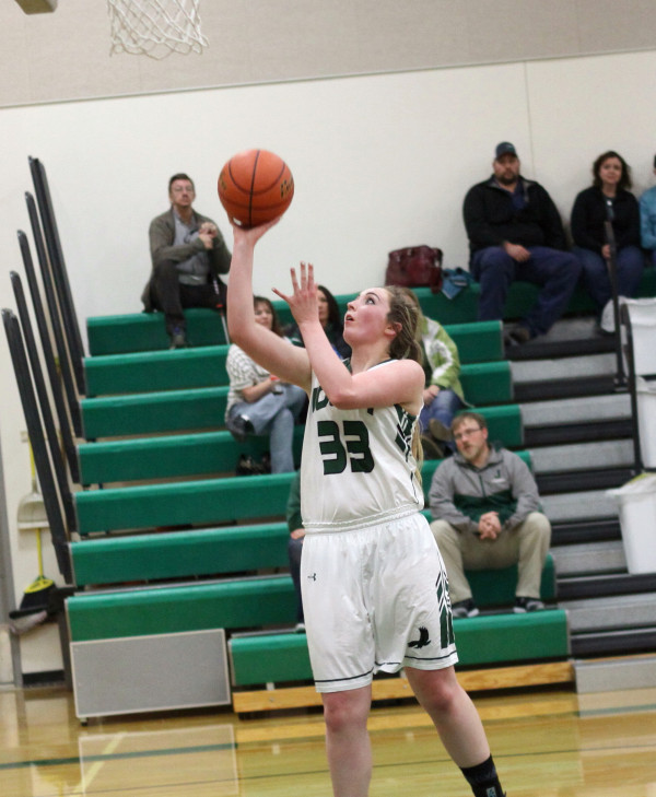 Photos courtesy of Hank Nowak Joliet's Holly Nowak is left all alone below the basket for an easy score in their win over the Mustangs.