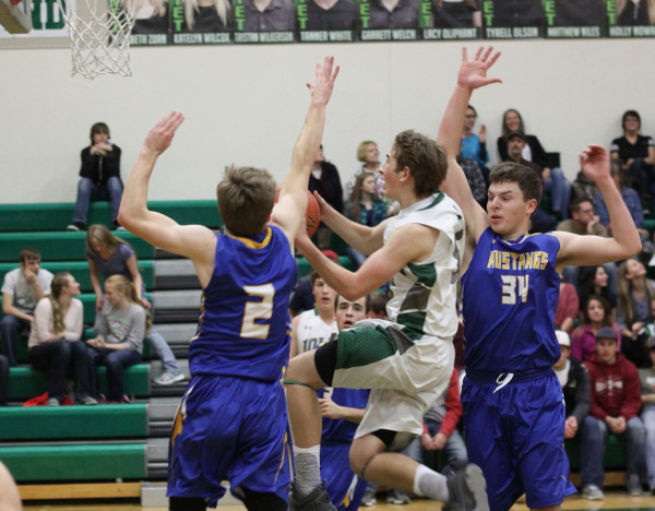 Photos courtesy of Hank Nowak Taylor Rowlison breaks through defenders in the J-Hawks one-point overtime loss to Shepherd.