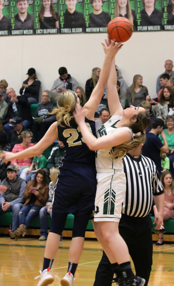 Photo of courtesy of Stacie Nardinger.  Holly Nowak goes up for the jump ball during the tip-off of the Lady J-Hawks senior night game against Red Lodge last week.