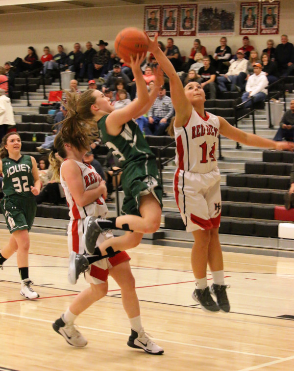 Photo courtesy of Hank Nowak.  Lady J-Hawk Shayla Webber goes up for a picturesque layup in her team's close four-point loss to Lodge Grass last Saturday.