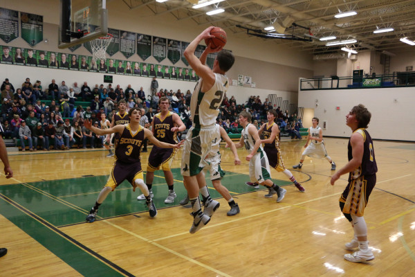 Ty Olson led all scorers as he pulls up for a short jumper in route to 16 points in the J-Hawks victory over Bridger.