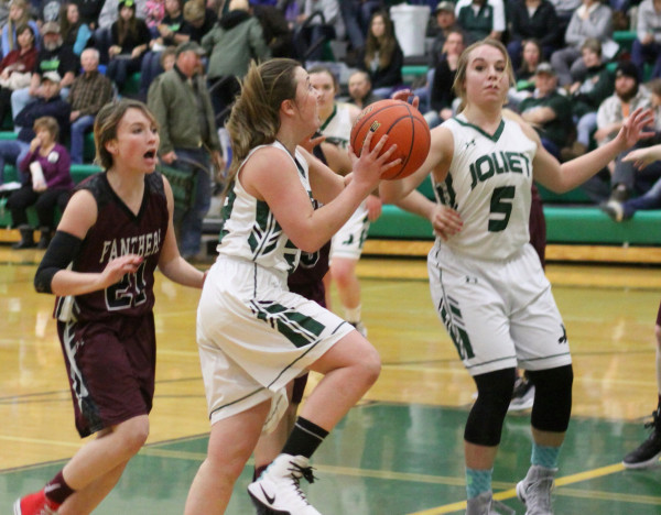 Photo courtesy of Hank Nowak.  Lady J-Hawk Danni Nardinger slashes to the lane for two of her 12 points in Joliet's win over the Panthers last week.