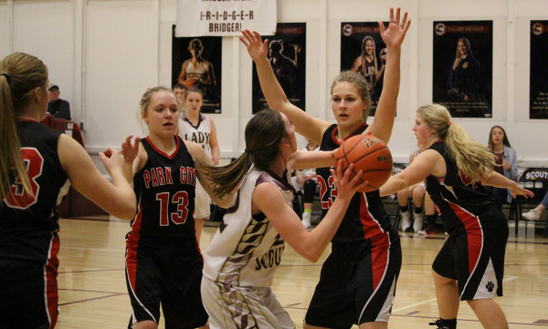 Pictures courtesy of Wendy Ray Kasidy Robbins, Blakely Verke, Shelby McMillen, Alyx Grabowska block a Bridger Scout shot during Thursday's game. Park City won the game 42-13.