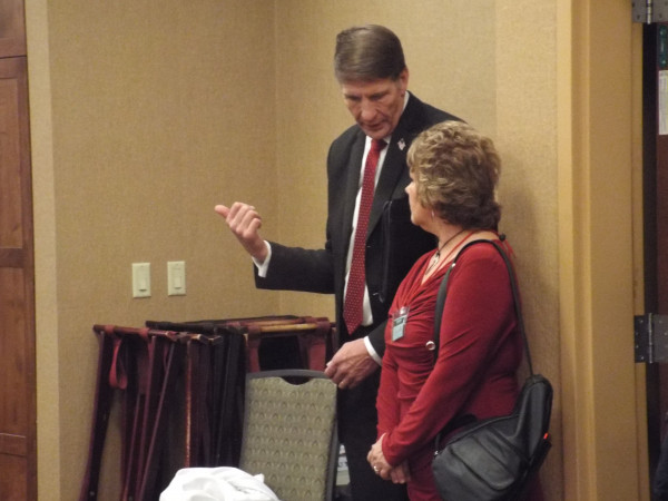 Ken and Peggy Miller, of Laurel, wait while votes are counted during the Republican mini-convention. Ken Miller was seeking the candidacy for Montana's sole House seat. He was defeated by Greg Gianforte.