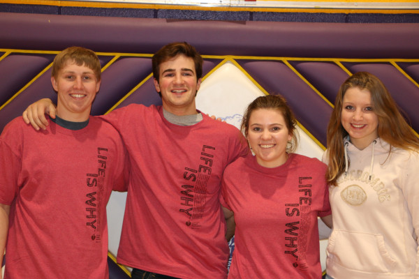 NHS students raising money for AHA shown from the left are Shay Osbourne, Zane Jarecke, Kallie Linse and Kallie Allen.
