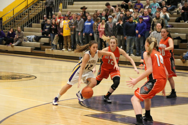 Photo by Garrett Harr.  Locomotive Aspen Cotter blows by defenders in her statement game of the season against Billings Senior. The sophomore had 18 points in the loss.
