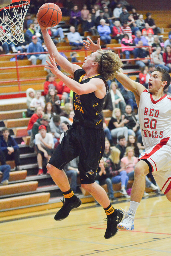 Photo courtesy of Gloria Allwin.  Layne Willis with his golden locks glides through the air for two of 11 points against Glendive last week.