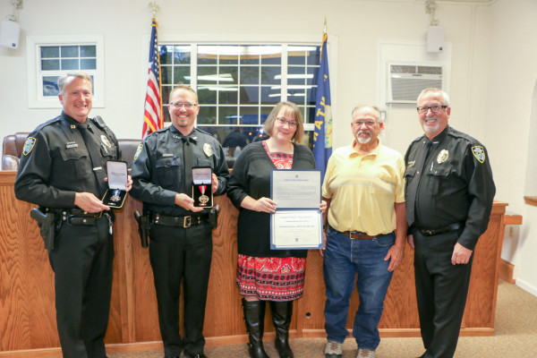 Outlook photo by Kathleen Gilluly. From the left is Captain Mark Guy, Officer Jeremiah Johnson, Communications Officer Brenda Sell, Mayor Mark Mace and Laurel Police Chief Rick Musson. Guy, Johnson and Sell were honored at Tuesday's city council meeting for their actions during an active shooter situation in Laurel in March.