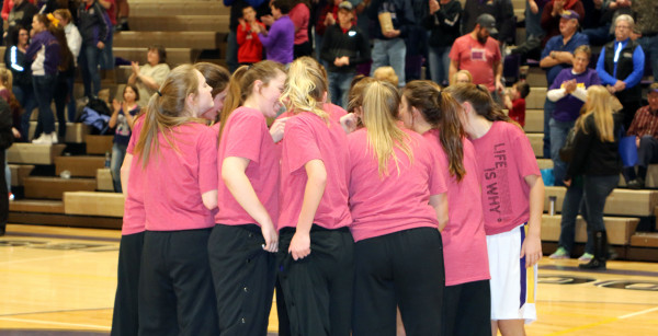 Photo by GARRETT HARR. During last week's home game against Glendive, all players, cheerleaders and fans participated in the red-out game by buying $8 dollar red-shirts for a good cause. Here the entire girls basketball team got into the caring spirit by wearing red shirts sponsored by the LHS National Honor Society.