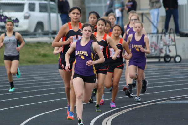 Photo by Garret Harr. Lady Locomotive Jessica Elmer leads the pack as she finished first in the women's 800 meter and 1600 meter runs at the Laurel Triangular meet last week.