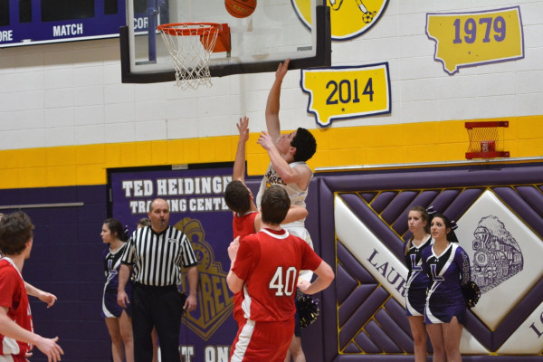 Photo courtesy of Gloria Allwin.  Dawson Cortese goes up for two in the Locomotive's 47-point annihilation of the Glendive Red Devils. He led his team in scoring with eleven points in the 73-27 victory and was a huge part of the team's current five-game win streak.