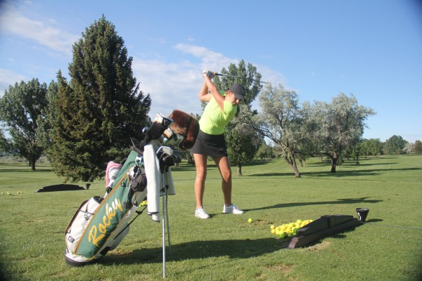 Outlook photo by Chris McConnell. Morgan O'Neil works on her swing at Laurel Golf Club a week after claiming a four-shot victory in the Barnett Memorial golf tournament at Missoula Country Club.