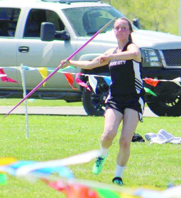 Photo by Kim Flemmer.  Brittany Frank broke the previous javelin record of 122-7 at the Stillwater meet with a throw of 127-9.