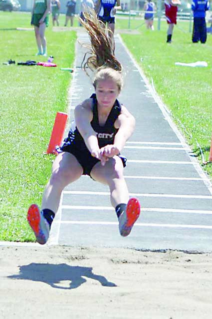 Photo by Kim Flemmer.  Mackinzie Verke broke the previous triple jump record with a jump of 35.2.