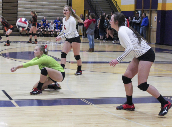 Outlook photo courtesy of Kim Flemmer.  Megan Flemmer digs a serve. Kasidy Robbins and Brittany Frank are pictured on either side. Park City hosted a volleyball tournament in Laurel last Saturday.