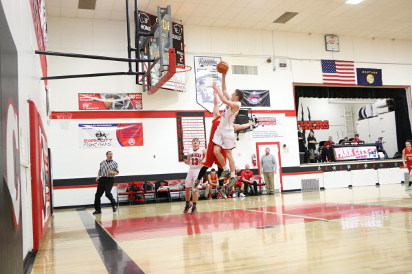 Photo by Garrett Harr.  Panther Brandon Flemmer goes one-on-one in the open court to give his team the advantage over Fromberg.