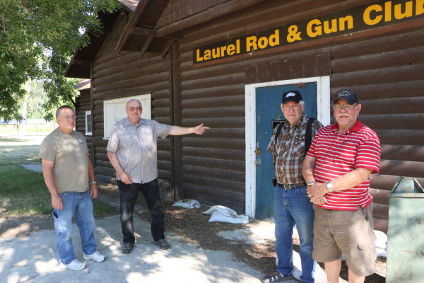 Rod and Gun Club Treasurer Curtis Lord with President Irv Wilke and members Ben Lewis and Ron Herman are concerned about the future of their building in Riverside Park. The men don't think city staff have been willing to work with them and are worried now that the historic buildings may be in jeopardy of demolition.