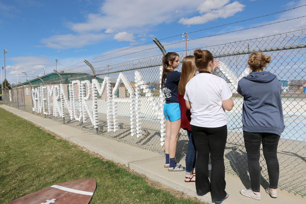 Laurel High School students decorated the fence by the Thomson park public swimming pool with a 'Save Mr. Norman' sign made out of cups with a heart at the very end in the continued protest of the school board's decision to not renew LHS principal Ed Norman's contract. The students, pictured from left are Brooke Anderson, Kyla Pollock, Sarah Hickock, and Karissa Pollock.