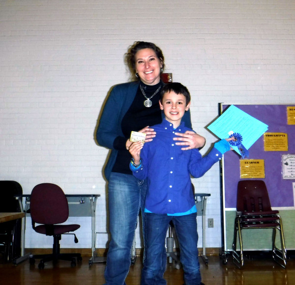 Congratulations to the winner of the science fair Xander Bergman. He is shown with the science fair coordinator after receiving his ribbon and $25 gift card.